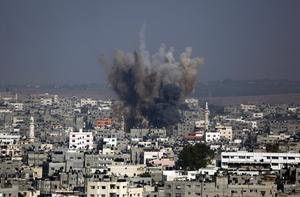 Smoke and debris from an Israeli strike rise over Gaza City, Tuesday, July 22, 2014. (AP Photo/Hatem Moussa)