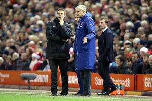 Arsenal manager Arsene Wenger talks to the fourth official on the touchline during the Barclays Premier League match at Anfield, Liverpool. Peter Byrne/PA Wire.