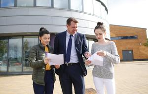 Assumption Grammar school pupils, Leah Taggart, left, 5 A stars, 4 A's and B, Lucy Aires 7 A stars and 3 A's with principal Peter Dobbin. Pic by Peter Morrison