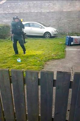 This is the moment cops prepared to Taser a male who armed himself with a pitchfork
