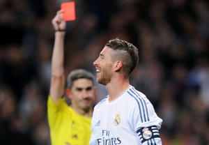 Sergio Ramos of Real Madrid is shown the red card by referee Alberto Undiano Mallenco during the La Liga match between Real Madrid CF and FC Barcelona at the Bernabeu on March 23, 2014 in Madrid, Spain.  (Photo by Denis Doyle/Getty Images)