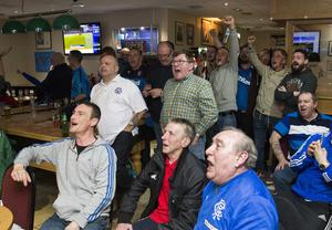 Fans at the Lagan Village Rangers Supporters Club celebrate after James Tavernier's goal secured promotion to Scotland's top tier after a four-year exile.