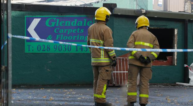 The scene of the suspected arson attack in west Belfast. Credit: Colm O'Reilly/Belfast Telegraph