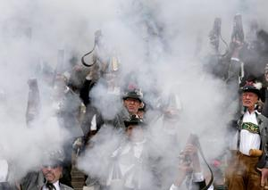 MUNICH, GERMANY - OCTOBER 05:  Bavarian riflemen of the Munich Salute Gun Regiment (Muenchner Boellerregiment) fire their traditional salute with one-shot guns on the steps under the Bavaria statue on the last day of the 2014 Oktoberfest on October 5, 2014 in Munich, Germany. The 181st Oktoberfest is coming to an end today an drew millions of visitors from across the globe in the world's largest beer fest.  (Photo by Johannes Simon/Getty Images)