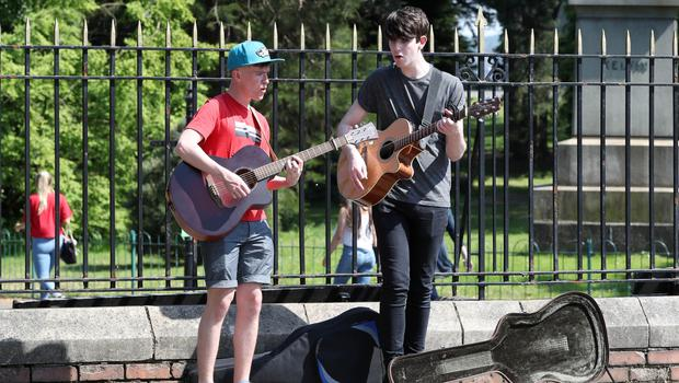 Press Eye - Weather Pictures - 25th May 2018 Photograph by Declan Roughan  (L-R) Conor Gormley and Caolan Teague  busking and enjoying the weather at Botanic Gardens, Belfast