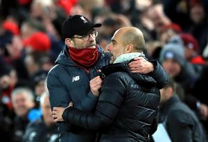 Jurgen Klopp and Pep Guardiola have an amicable rivalry (Peter Byrne/PA)