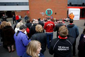 People gather at Anfield around the Hillsborough memorial before the last memorial service to be held at the Liverpool ground to mark 27 years to the day since the tragedy claimed 96 lives. PRESS ASSOCIATION Photo. Picture date: Friday April 15, 2016. The 96 Liverpool fans died in the crush on the Leppings Lane terraces at Sheffield Wednesday's Hillsborough stadium after going to see their team play Nottingham Forest in an FA Cup semi-final on April 15, 1989. See PA story MEMORIAL Hillsborough. Photo credit should read: Peter Byrne/PA Wire