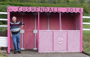 Northern Ireland- 29th April 2014 Mandatory Credit - Presseye.com  The Antrim coast turns pink ahead of next week's giro d'italia which will pass through the Northern Ireland beauty spot on day two of the bicycle race.  Seamus McGinty waits for a bus at his local bus stop in Cushendall, Co. Antrim.