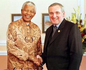 File photo dated 16/06/1998 of South African President Nelson Mandela greeting  Irish Taoiseach Bertie Aherne at the Euro Summit in Cardiff. Former South African leader Nelson Mandela has died at the age of 95, the country's president, Jacob Zuma, said tonight. PRESS ASSOCIATION Photo. Issue date: Thursday December 5, 2013. See PA story DEATH Mandela. Photo credit should read Jay Williams/PA Wire