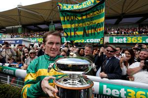 ESHER, ENGLAND - APRIL 25: Tony McCoy with the jockeys championship trophy he wins for the 20th consecutive time on the day he retires from the saddle at Sandown racecourse on April 25, 2015 in Esher, England. (Photo by Alan Crowhurst/Getty Images)
