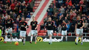Manchester United's English striker Wayne Rooney (C) leads his teammates off of the pitch following the English Premier League football match between Sunderland and Manchester United at the Stadium of Light in Sunderland, northeast England on February 13, 2016.  Sunderland won the match 2-1. / AFP / OLI SCARFF /