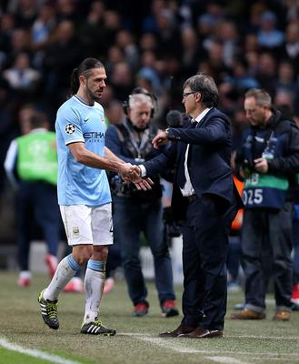 Manchester City's Martin Demichelis shakes hands with Barcelona's manager Gerardo Martino after being shown a red card during the UEFA Champions League, Round of 16 match at the Etihad Stadium, Manchester. PRESS ASSOCIATION Photo. Picture date: Tuesday February 18, 2014. See PA story SOCCER Man City. Photo credit should read: Peter Byrne/PA Wire