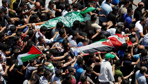Palestinian mourners carry the bodies of Taib Mohammed Odeh, 22, front, and Khaled Odeh, 21, during their funeral in Hawara near Nablus, the northern West Bank, Saturday, July 26, 2014.  (AP Photo/Nasser Ishtayeh)