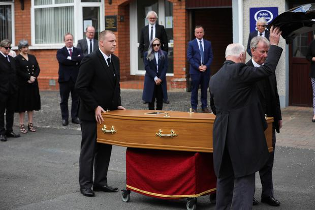 Press Eye - Belfast - Northern Ireland - 4th May 2020 -    Family and friends pictured at the funeral of actor BJ Hogg in Lisburn, County Antrim. He was best known as Big Mervyn in the BBC series Give My Head Peace, but BJ Hogg was also a hugely versatile TV, stage and screen actor.  Mr Hogg's wife Elish McDonnell Hogg, son Nathan and daughter Abigail joined other family and friends.   Photo by Kelvin Boyes / Press Eye.