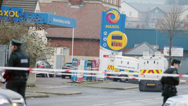 the scene at a petrol station on the Crumlin Road in north Belfast where an on duty PSNI officer was shot in the arm from a passing car on Sunday evening.