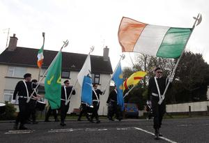 Northern Ireland- 23rd February 2014 Mandatory Credit - Photo-Jonathan Porter/Presseye.  30th anniversary parade for IRA members Henry Hogan and Declan Martin in Dunloy who were shot dead by the British Army in the Co. Antrim village in 1984.