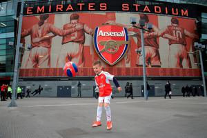 "Six-year-old Alfie plays football outside the ground before the Barclays Premier League match at the Emirates Stadium, London. PRESS ASSOCIATION Photo. Picture date: Thursday April 21, 2016. See PA story SOCCER Arsenal. Photo credit should read: Nick Potts/PA Wire. RESTRICTIONS: EDITORIAL USE ONLY. No use with unauthorised audio, video, data, fixture lists, club/league logos or ""live"" services. Online in-match use limited to 75 images, no video emulation. No use in betting, games or single club/league/player publications."