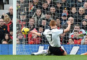 Fulham's Steve Sidwell scores his teams opening goal during the Barclays Premier League match at Old Trafford, Manchester.