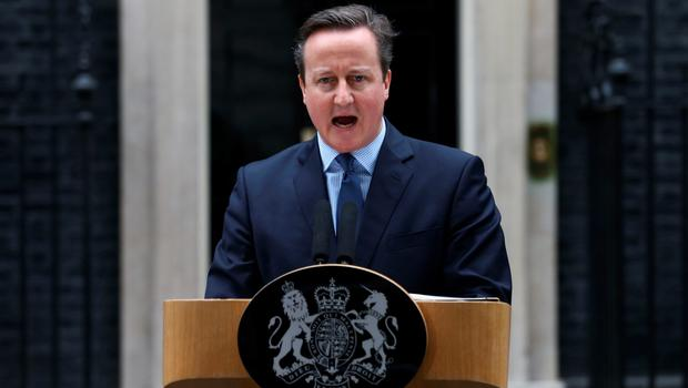 Prime Minister David Cameron makes a statement to the media outside 10 Downing Street in London on February 20 , 2016 regarding the EU negotiations and to announce the date of the in-out EU referendum after chairing a meeting of the cabinet.