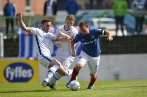 Stephen O'Donnell (left) gets in a challenge on Jamie Mulgrew during Coleraine's Charity Shield defeat to Linfield.