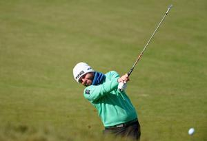NEWCASTLE, NORTHERN IRELAND - MAY 29:  Andy Sullivan of England hits his 2nd shot on the 13th hole during the Second Round of the Dubai Duty Free Irish Open Hosted by the Rory Foundation at Royal County Down Golf Club on May 29, 2015 in Newcastle, Northern Ireland.  (Photo by Ross Kinnaird/Getty Images)