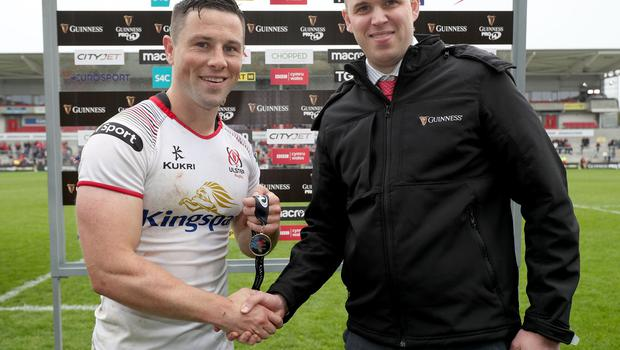 Ulster's John Cooney receives the man of the match award from John Haggan.