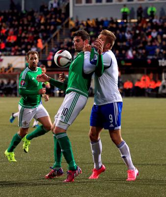 Northern Ireland's Kyle Lafferty and Faroe Islands' Gilli Sorensen battle for the ball during the UEFA European Championship Qualifying match at the Torsvollur, Torshavn. Picture date: Friday September 4, 2015. See PA story SOCCER Faroe Islands. Photo credit should read: John Walton/PA Wire.