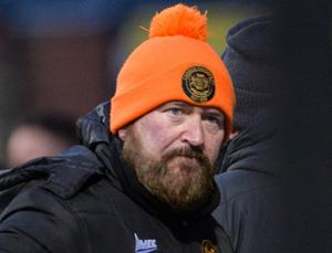 Carrick Rangers boss Niall Currie would love nothing more than to be swapping his bobble hat for a sombrero on the sidelines.
