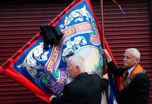 Bandsmen and Orange Order members gather ahead of an Orange Order parade in  Belfast, as part of the annual Twelfth of July celebrations, marking the victory of King William III's victory over James II at the Battle of the Boyne in 1690. PRESS ASSOCIATION Photo. Picture date: Friday July 12, 2019. See PA story ULSTER Twelfth. Photo credit should read: Brian Lawless/PA Wire