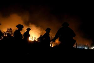 CLEARLAKE, CA - AUGUST 03:  Cal Fire firefighters monitor a backfire as they battle the Rocky Fire on August 3, 2015 near Clearlake, California. Nearly 3,000 firefighters are battling the Rocky Fire that has burned over 60,000 acres has forced the evacuation of 12,000 residents in Lake County. The fire is currently 12 percent contained and has destroyed at least 14 homes. 6,300 homes are threatened by the fast moving  blaze.  (Photo by Justin Sullivan/Getty Images)