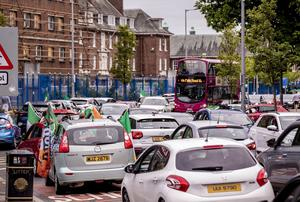 Hundreds of cars on the Falls road in west Belfast celebrate Celtics title win on May 18th 2020 (Photo by Kevin Scott for Belfast Telegraph)