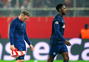 PIRAEUS, GREECE - FEBRUARY 25:  Danny Welbeck (R) and Wayne Rooney (L) of Manchester United leave the field at the end of the UEFA Champions League Round of 16 first leg match between Olympiacos FC and Manchester United at Karaiskakis Stadium on February 25, 2014 in Piraeus, Greece.  (Photo by Michael Regan/Getty Images)