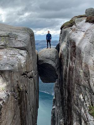 Paulo Ross on the famous Kjerag boulder which is wedged 1000m above the Norwegian mountains