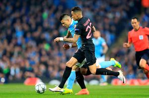 Manchester City's Sergio Aguero (left) and Paris Saint-Germain's Gregory Van Der Wiel battle for the ball during the UEFA Champions League Quarter Final, Second Leg match at the Etihad Stadium, Manchester. Nigel French/PA Wire