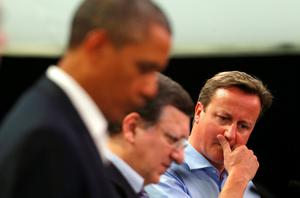 Prime Minister David Cameron attends a news conference with US President Barack Obama and European Commission President Jose Manuel Barroso (centre) at the G8 summit in Enniskillen, Northern Ireland. PRESS ASSOCIATION Photo. Picture date: Monday June 17, 2013. See PA story POLITICS G8. Photo credit should read: Andrew Winning/PA Wire