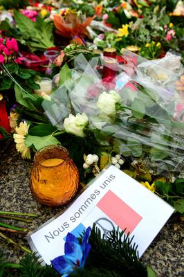 "A message reads "" We are united "" amount flowers and candles on the ground outside the French embassy in Berlin, on November 16, 2015 three days after deadly attacks in Paris. The string of coordinated attacks in and around Paris late November 13, 2015 left at  least 129 people dead, in the worst such violence in France's history.  AFP PHOTO / JOHN MACDOUGALLJOHN MACDOUGALL/AFP/Getty Images"