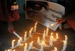 Indian school children light candles during a vigil at a school in Siliguri on November 16, 2015, following coordinated terror attacks in the French capital Paris. Islamic State jihadists claimed a series of coordinated attacks by gunmen and suicide bombers in Paris on November 13 that killed at least 129 people and injured 352 in scenes of carnage at a concert hall, restaurants and the national stadium. AFP PHOTO / Diptendu DUTTADIPTENDU DUTTA/AFP/Getty Images