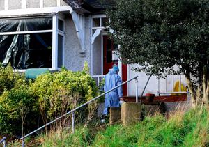 A police forensic officer enters the house in Erith, Kent, which is being searched by police officers in relation to the missing former Eastenders actress Sian Blake. Gareth Fuller/PA Wire