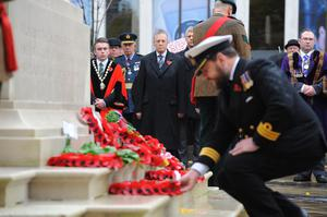 An officer of the Royal Navy lays a wreath at the Cenotaph in Belfast City. Pic: Aaron McCracken/Harrisons.