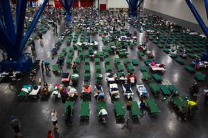 HOUSTON, TX - AUGUST 28:  Evacuees fill up cots at the George Brown Convention Center that has been turned into a shelter run by the American Red Cross to house victims of the high water from Hurricane Harvey on August 28, 2017 in Houston, Texas. Harvey, which made landfall north of Corpus Christi late Friday evening, is expected to dump upwards to 40 inches of rain in areas of Texas over the next couple of days.  (Photo by Erich Schlegel/Getty Images)
