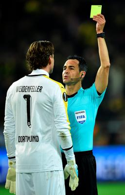 DORTMUND, GERMANY - APRIL 07:  Referee Carlos Velasco Carballo shows a yellow card to Roman Weidenfeller of Borussia Dortmund  during the UEFA Europa League quarter final first leg match between Borussia Dortmund and Liverpool at Signal Iduna Park on April 7, 2016 in Dortmund, Germany.  (Photo by Stuart Franklin/Bongarts/Getty Images)