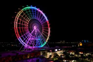 The Orlando Eye observation wheel lights up in rainbow colors Sunday night, June 12, 2016, to remember the people killed and injured in the Pulse nightclub shooting, the deadliest mass shooting in U.S. history. (Joshua Lim/Orlando Sentinel via AP)