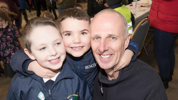 Noel McKee who organised a schools party for Hill Croft School at Whitla Fire station.  With Hill Croft School pupils Adam Armstrong and Andrew Henderson. Picture Colm O'Reilly Sunday Life