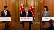 Prime Minister Boris Johnson (centre), Chancellor Rishi Sunak (left) and Dr Jenny Harries (right) speaking at a media briefing in Downing Street, London, on coronavirus (COVID-19). Photo credit: PA Video/PA Wire