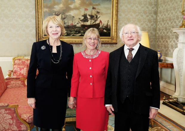 Sally O'Neill with Michael D Higgins and his wife Sabina Coyle on her retirement in 2015.