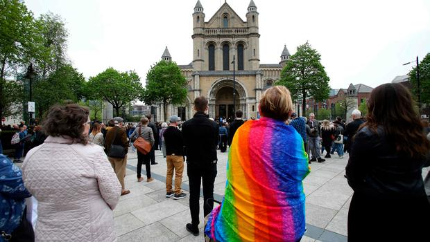 Mourners gather outside of St Anne's Cathedral in Belfast on April 24, 2019, during the funeral service of journalist Lyra McKee who was killed by a dissident republican paramilitary in Northern Ireland on April 18. - Lyra McKee, 29, who chronicled the troubled history of Northern Ireland, was shot in the head on April 18, 2019, as rioters clashed with police in Londonderry, the second city of the British province. (Photo by Paul Faith / AFP)PAUL FAITH/AFP/Getty Images