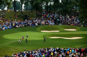 LOUISVILLE, KY - AUGUST 08:  Rory McIlroy of Northern Ireland, Martin Kaymer of Germany and Bubba Watson of the United States walk onto the 14th green during the second round of the 96th PGA Championship at Valhalla Golf Club on August 8, 2014 in Louisville, Kentucky.  (Photo by Andrew Redington/Getty Images)
