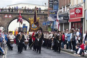 The Apprentice Boys 324th Annual Commemoration makes its way through Ferryquay Gate Derry, on Saturday 10th August 2013.