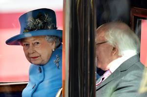 WIQueen Elizabeth II (L) and Irish President Michael D. Higgins (R) ride in a horse-drawn carriage during a ceremonial welcome at Windsor Castle on April 8, 2014 in England. This is the first official visit by the head of state of the Irish Republic to the United Kingdom.  (Photo by Ben Stansall/Getty Images)