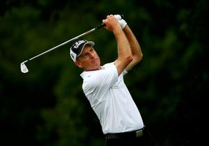 LOUISVILLE, KY - AUGUST 10:  Jim Furyk of the United States hits his tee shot on the eighth hole during the final round of the 96th PGA Championship at Valhalla Golf Club on August 10, 2014 in Louisville, Kentucky.  (Photo by Sam Greenwood/Getty Images)
